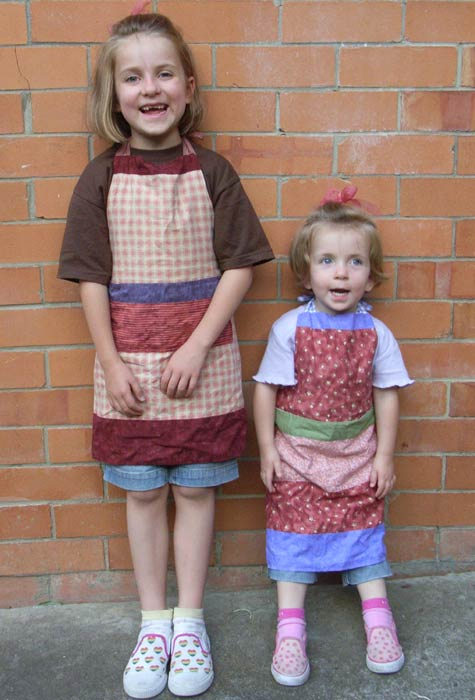 Amelia and Michaela in aprons