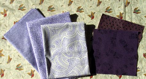 Purple Fabrics and Charm Squares