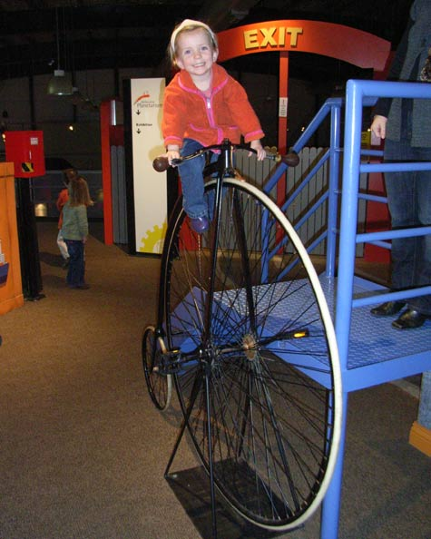 Michaela on a penny Farthing