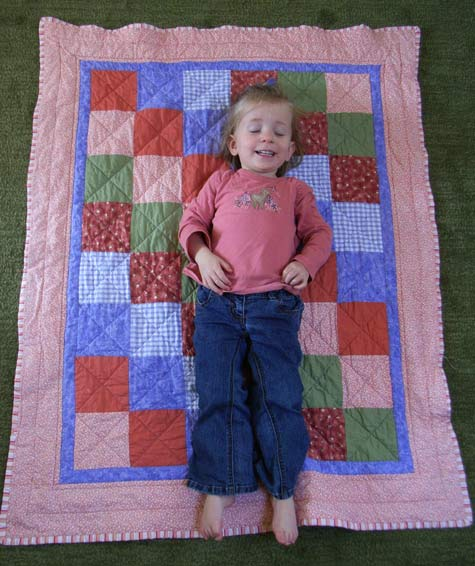Michaela on her baby quilt