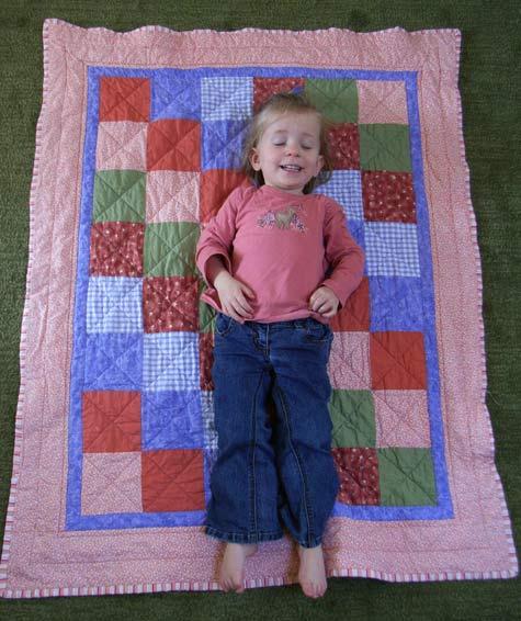Michaela on her baby quilt