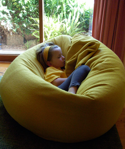 Michaela asleep in a beanbag