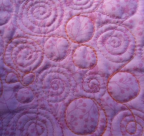 Swirly Quilting on the back of the quilt