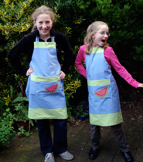 Olivia and Amelia in the aprons they made