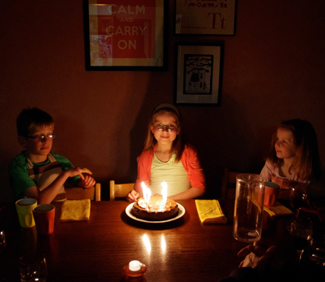 Amelia with her birthday cake and siblings