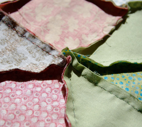 Six segments of fabric meet at the seams