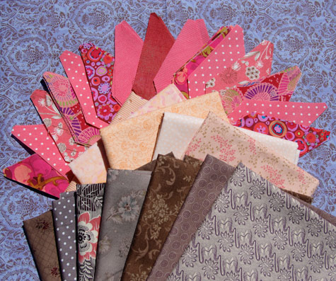 Very bright coral diamonds, peach fabrics and brown fabrics for my quilt