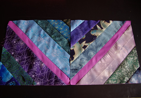 Finished String Blocks, pieced onto the cyclamen background