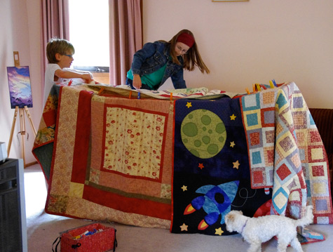 Amelia and Rory build a cubby house with quilts