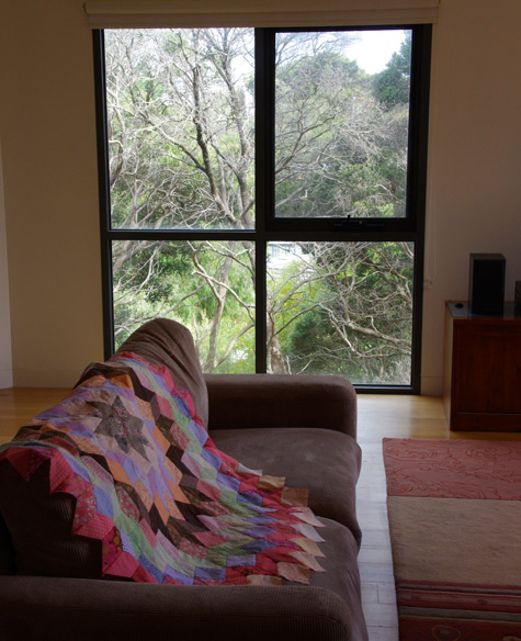 Beach house interior with quilt