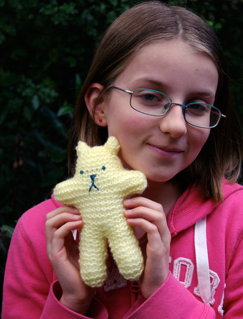 Amelia with the small Teddy that she knitted