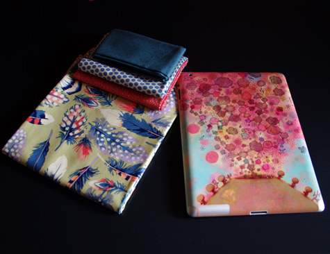 My ipad2 in it's Gelaskins covers, with the fabric I plan on using to make a soft case