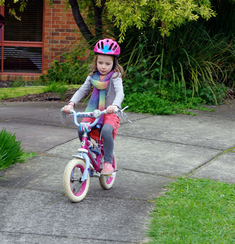 Michaela riding her bike