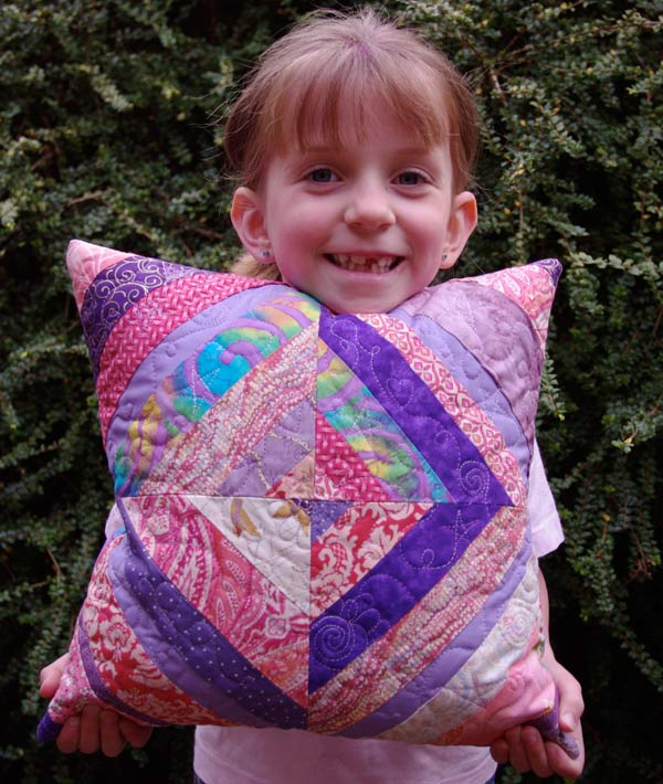 Michaela with the cushion she made