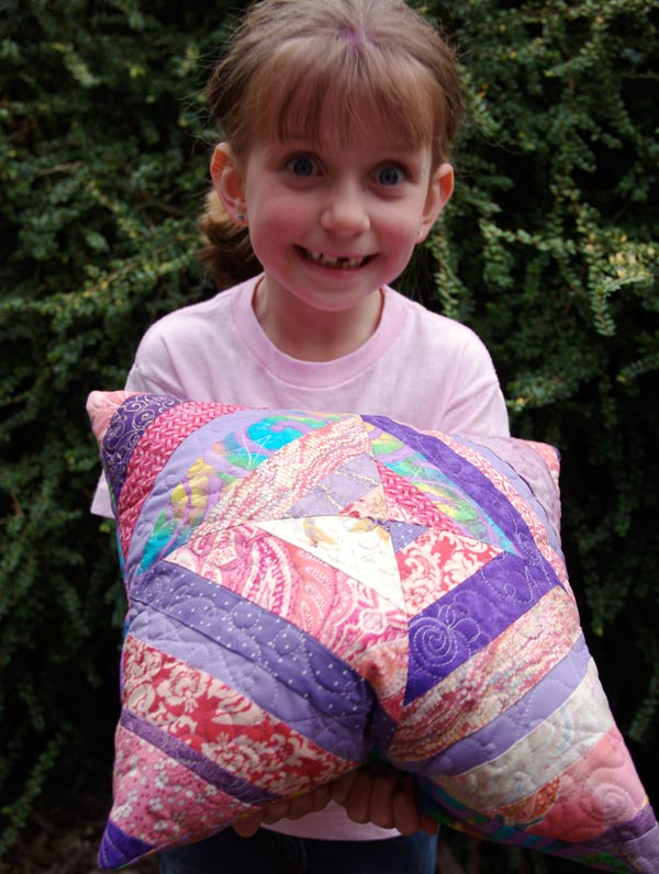 Michaela with the cushion that she made