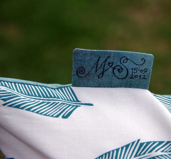 "M & S tag on the ""wedding cushion"" which includes the wedding date."