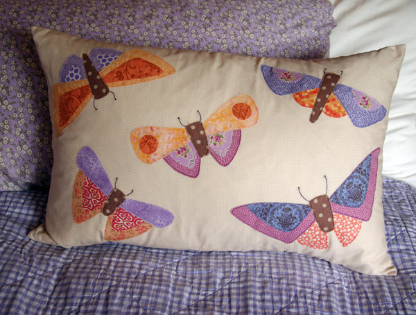 """All A Flutter"" cushion by ""Matching Pegs"" in sunset colour way"