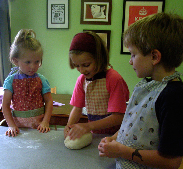 3 kids kneading dough