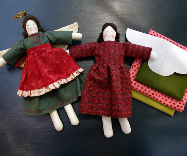 Unfinished Angel and fabrics at right, finished sample at left.