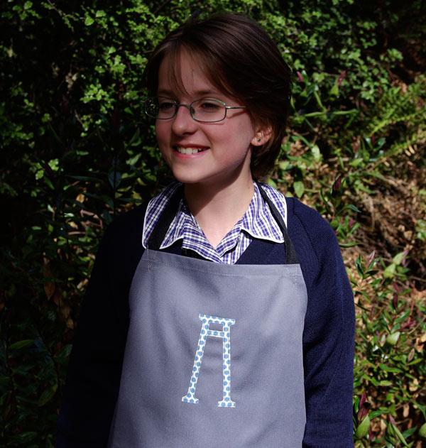 Personalising Amelia's art apron
