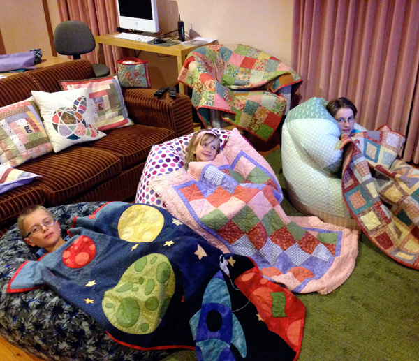 Watching Dr Who, on home made beanbags, and under home made quilts