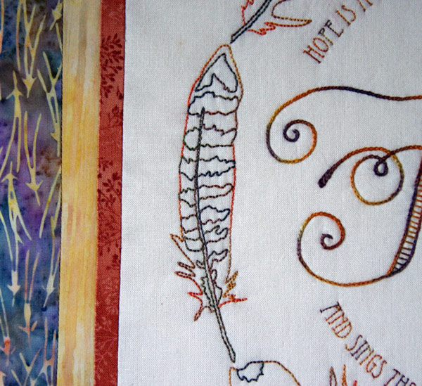 "Detail of ""Hope is a thing with feathers"" stitchery"