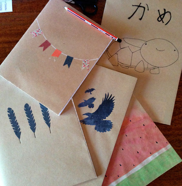 Covering exercise books with brown paper and washi tape. Matching Pegs