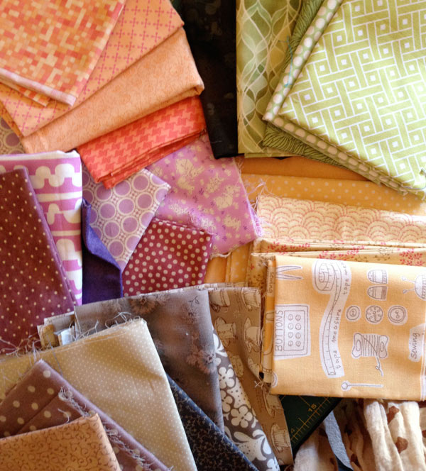 A pile of harmonious fabrics for a quilt :: Matching Pegs